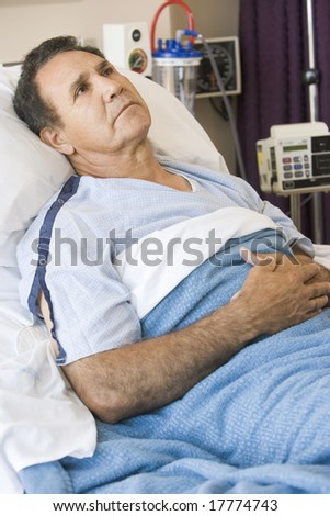 Middle Aged Man Lying In Hospital Bed - stock photo