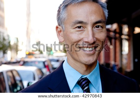 Middle aged man on city street. Horizontally framed shot. - stock photo
