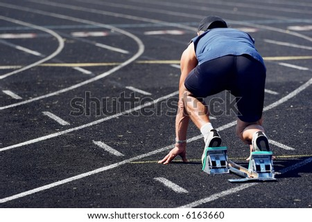 middle-aged man on the starting line of a race - stock photo