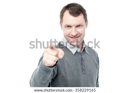 Middle aged man pointing finger at camera - stock photo