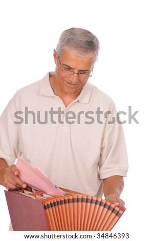 Middle Aged Man Putting Papers in File Box isolated on white