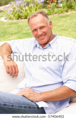 Middle Aged Man Relaxing In Garden - stock photo
