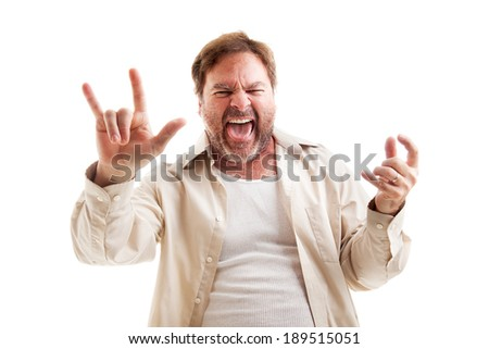 Middle-aged man rocks out playing air guitar and making the rock-n-roll symbol.  Isolated on white.   - stock photo