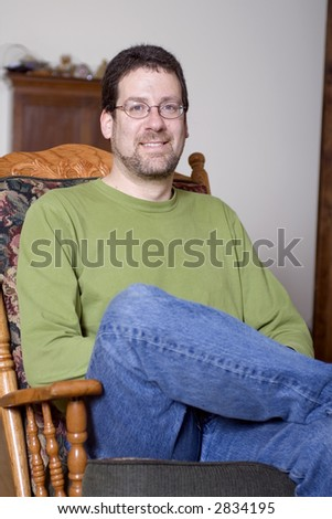 Middle aged man sitting in a rocking chair