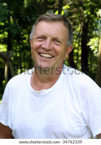 Middle-aged man smiling. - stock photo