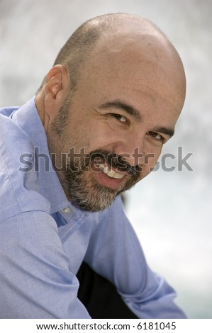 Middle aged man smiling - balding, middle aged man smiling