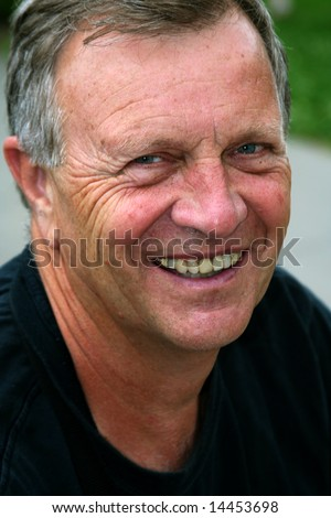 Middle-aged man smiling for a portrait. - stock photo