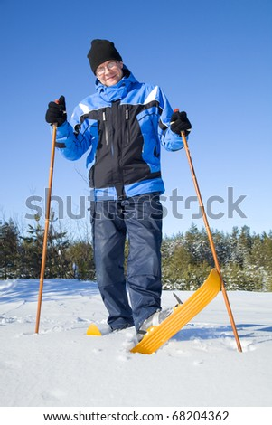 Middle-aged man smiling on skis - stock photo