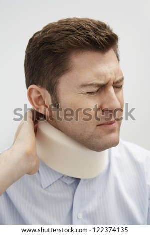 Middle aged man suffering from neck pain - stock photo