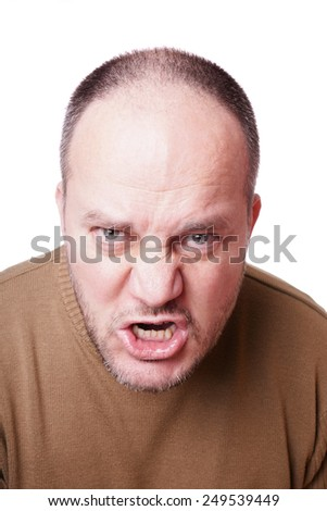 middle aged man with a mad expression on his face shouting - stock photo
