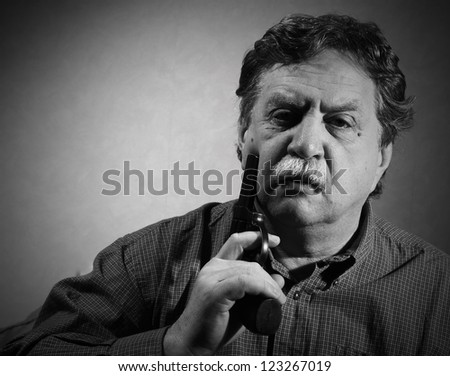 middle aged man with a revolver - stock photo