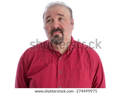 Middle-aged man with baldness and goatee beard wearing a dark red shirt while looking up to the left with a sad and depressed facial expression, isolated portrait on white - stock photo
