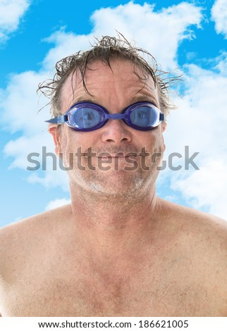 Middle Aged Man with Blue Swimming Goggles - stock photo