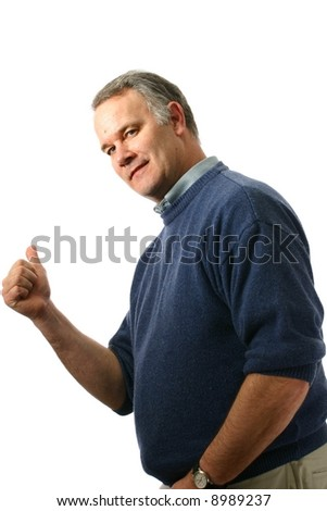Middle-aged man with his thumb out as though hitchhiking - stock photo
