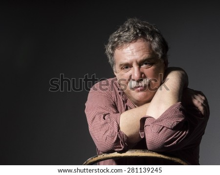 middle-aged man with mustashe  - stock photo