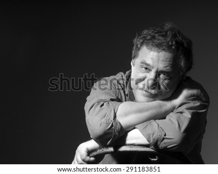 middle-aged man with mustashe