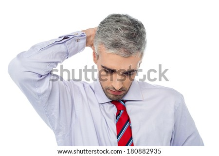 Middle aged man with the compress on neck - stock photo