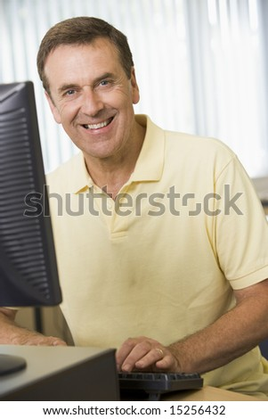 Middle aged man working on a computer - stock photo
