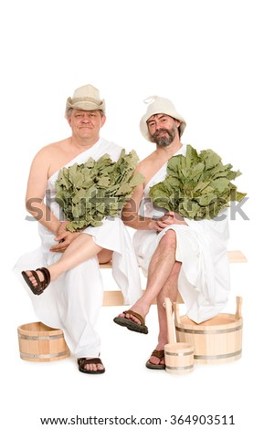Middle-aged men in traditional Russian sauna bathing costumes. From a series of Russian bath - stock photo