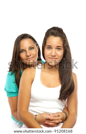 Middle-aged mother hugging her daughter isolated on white background - stock photo