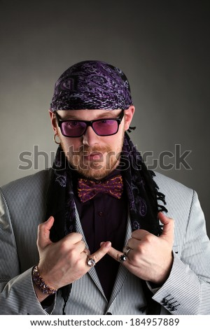 Middle-aged red-haired artist posing at camera - stock photo