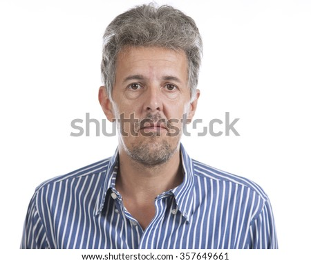 Middle-aged serious man studio portrait on white background