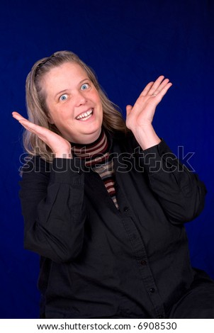 Middle aged Surprised woman over a blue gradient background - stock photo