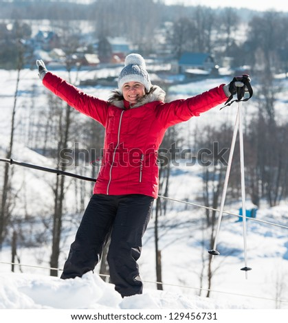 middle-aged woman alpine skiing in the snow in winter - stock photo
