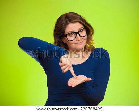 middle aged woman asking to pay money back, finger on palm gesture, isolated green background. Human face expression, emotions, feeling, body language non verbal communication. Financial debt concept - stock photo