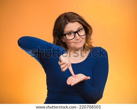 middle aged woman asking to pay money back, finger on palm gesture, isolated orange background. Human face expression, emotions, feeling, body language non verbal communication. Financial debt concept - stock photo