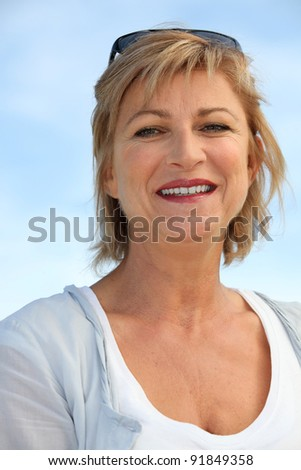 Middle-aged woman at the seaside - stock photo