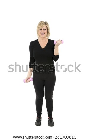 Middle aged woman doing arm exercises against a white background - stock photo