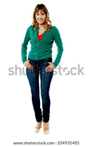 Middle aged woman in trendy outfit striking stylish pose - stock photo