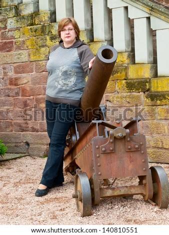 Middle-aged woman near an old cannon. A walk in Saarbrucken, Deutschland - stock photo