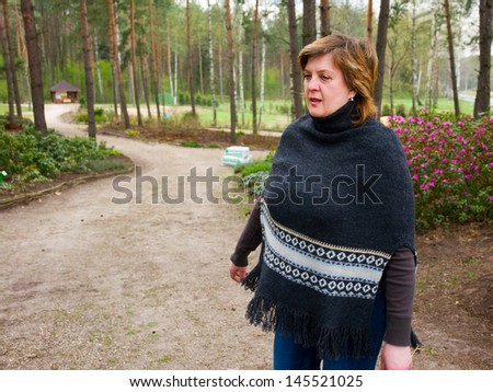Middle-aged woman resting in a city park - stock photo