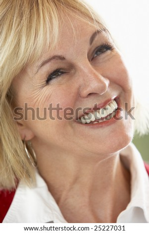 Middle Aged Woman Smiling Cheerfully - stock photo