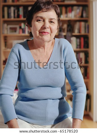 Middle-aged woman smiling for the camera - stock photo
