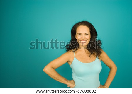Middle aged woman smiling for the camera - stock photo