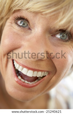 Middle Aged Woman Smiling Happily