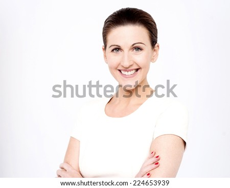 Middle aged woman standing with crossed arms  - stock photo