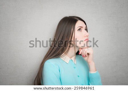 middle aged woman thinking and looking up - stock photo