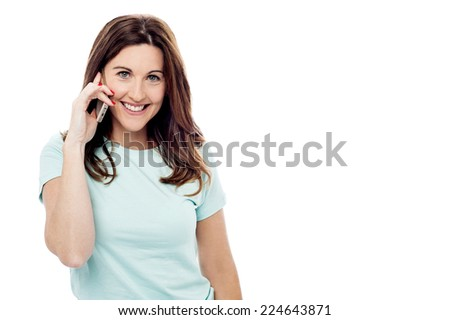 Middle aged woman using mobile phone, isolated on white - stock photo