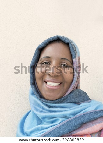 Middle-aged woman wearing a blue headscarf  - stock photo