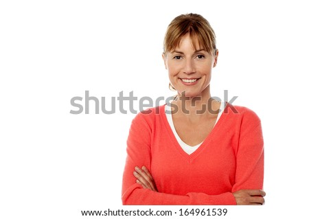 Middle aged woman wearing a bright smile. - stock photo