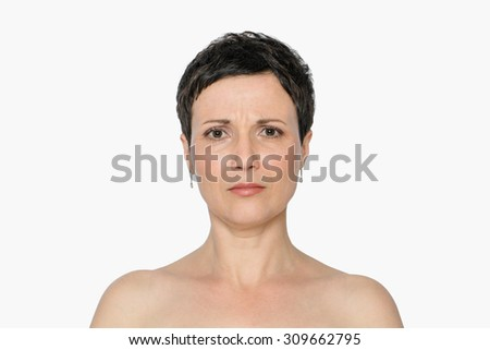 Middle-aged woman with aging singes and problems, double chin, worry wrinkles, nasolabial folds. Natural look. Isolated, with copy space. - stock photo