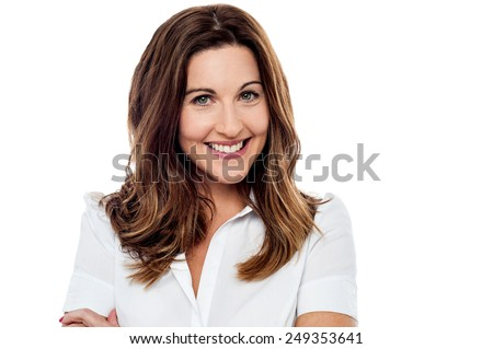 Middle aged woman with welcoming smile - stock photo