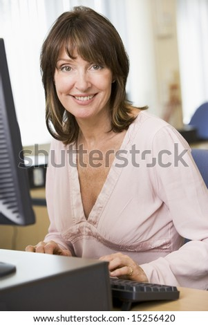 Middle aged woman working on a computer - stock photo