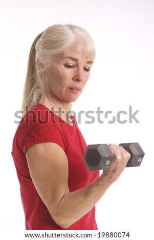 Middle-aged woman working out with barbell isolated against white background - stock photo