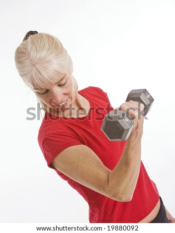 Middle-aged woman working out with small barbell isolated against white background - stock photo