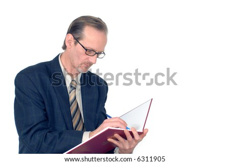 Middle aged  workaholic, businessman making notes in notebook - stock photo